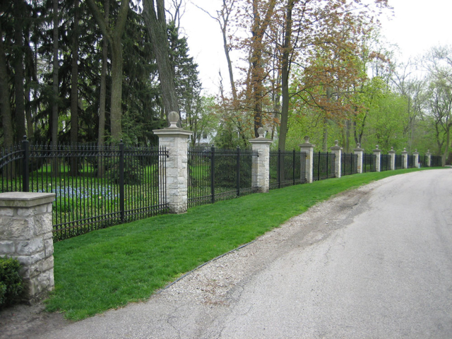 M-0752 - Wrought Iron Fence with Stone Pillars
