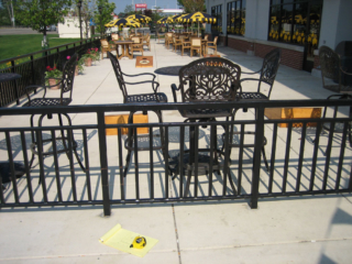 M-0716 - Wrought Iron Commercial Fence Surrounding Outdoor Seating at Restaurant
