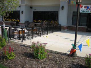 M-0717 - Wrought Iron Commercial Fence Surrounding Outdoor Seating at Restaurant